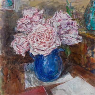 pink flowers in a blue vase
